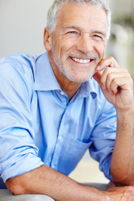 Confident man is smiling after getting dentures in Sacramento, CA at Rho Family Dentistry